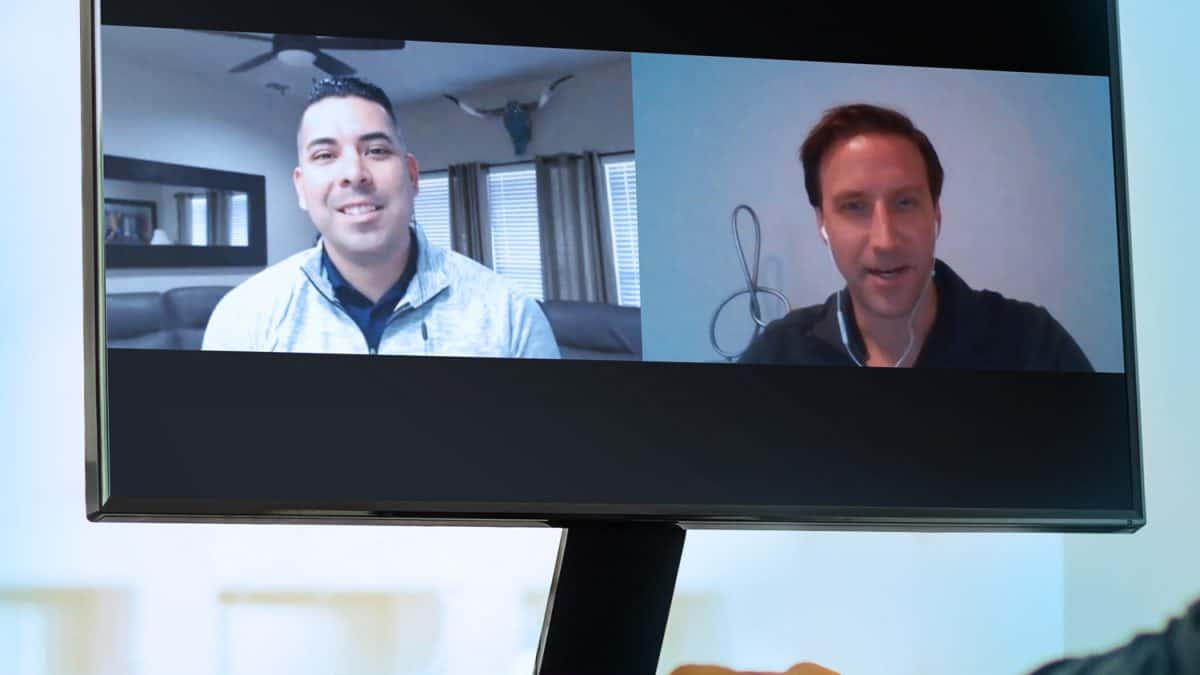Desktop screen shows picture of Tim and Adrian Luna