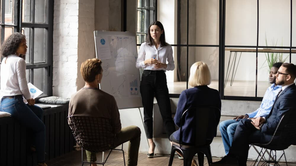 lady business trainer coach leader give flip chart presentation