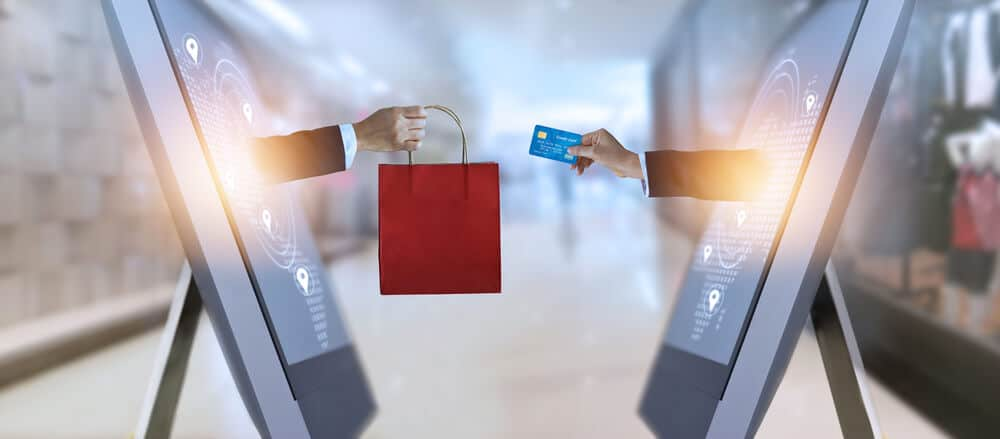 e-commerce, hand holding shopping bag and credit card