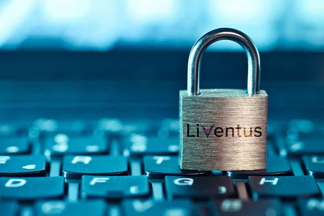 lock with liventus logo placed on laptop keypad