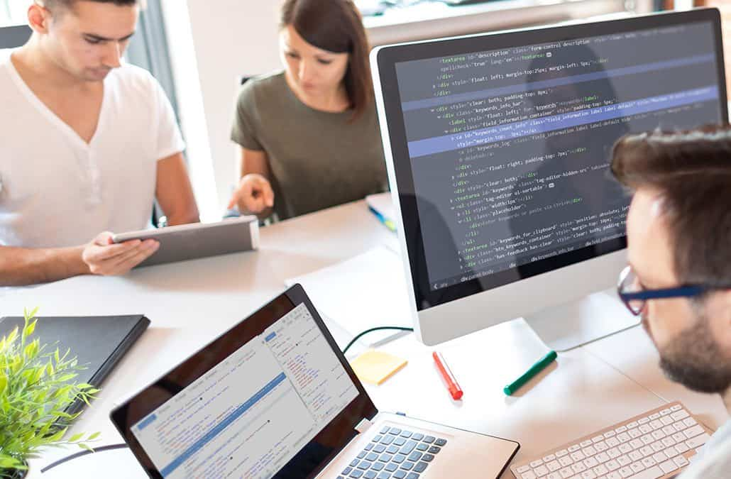three people working in the office